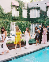guests walk along pool side cocktail hour