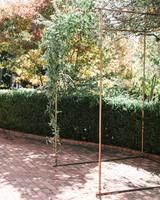 copper piping and green garland chuppah