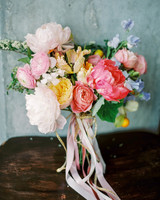 pink-and-white peony bouquet with blush ranunculus, yellow roses, and purple sweet peas