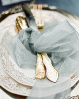 antique silverware wrapped in gray tulle