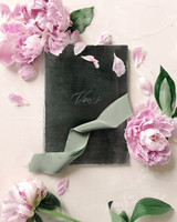 vow books sage green with pink flowers and ribbon