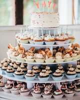 four tiered cupcake stand with mini cake on top
