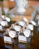 alcohol escort cards liquor in labeled apothecary bottles