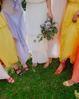 bridesmaids showing their colorful shoes and dresses