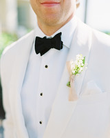 beth john wedding boutonniere on white suit