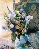 White, light blue, and purple floral bouquet