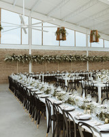 white tables with dark wood chairs minimal reception set up
