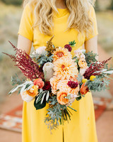 bride yellow dress dahlia bouquet orange flowers red green