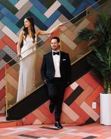 krista will wedding couple posing on art deco staircase