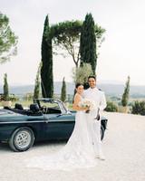 kseniya sadhir wedding couple posing in front of vintage car