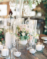 various sized candle display with mini rose arrangement