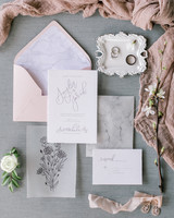 gray and light pink stationary suit with gray marble accents and floral design