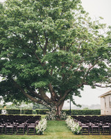 outdoor country wedding ceremony set up with large tree