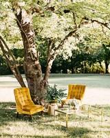 mustard yellow velvet lounge chairs beneath tree