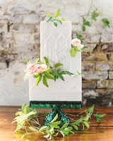 cubed wedding asymmetrical white cake with flowers and greenery