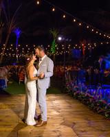 bride and groom share first dance on outdoor wooden dance floor