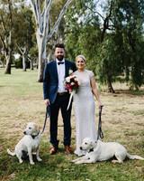 dog wedding bride groom couple labrador retrievers white leashes