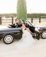bride and groom sitting in black vintage car