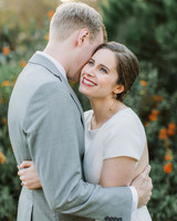 bride and groom hugging outside during wedding portraits