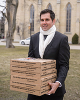 wedding guest carrying pizza boxes