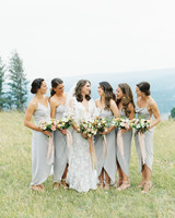 bridal part outside wearing oyster colored bridesmaids dresses