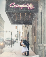 Couple Kissing in Front of Sign
