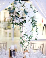 tall centerpiece with white garden roses and orchids