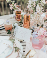 chilled pink bubbly at floral place setting