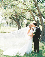 amanda chuck wedding couple kiss under the trees
