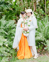 anuja nikhil wedding ceremony couple bride orange dress