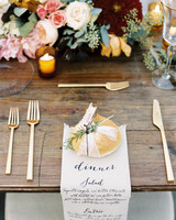 bread holding menu on wooden table