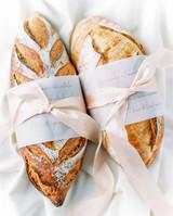 bread loaves in calligraphed sleeves