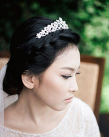 bride wearing textured bun with a classic crown