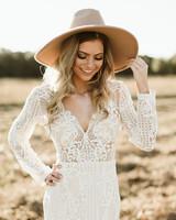 bride wearing tan hat