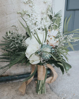 brides bouquet of palm leaves and succulents