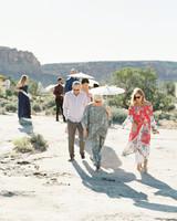 jeanette david wedding parasols guests desert