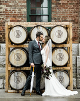 bride and groom kiss at distillery courtyard