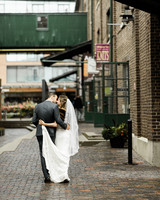 bride and groom walking away holding each other