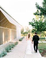 amanda chuck wedding couple walking by venue