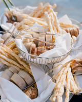 assortment of bread in wire baskets