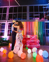brewery wedding venues colorful lights first dance