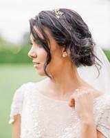 bride wearing floral headpiece crown