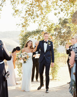 bride and groom walking down recessional aisle