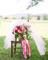 dawn rich wedding pink bouquet on chair in the grass
