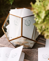 seed paper wedding programs in glass container