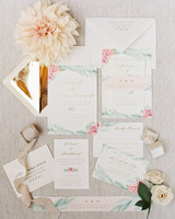 white invitations with floral border