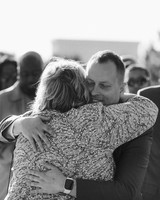 henery michael wedding ceremony groom and mother hugging