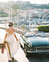 bride wearing Phoebe by Kelly Faetanini next to vintage car