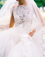 bride wearing lace bodice wedding gown