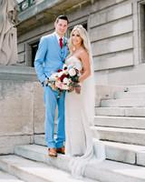 bride and groom posing on steps
